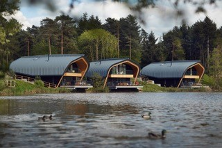 Balancing nature with wooden building at Center Parcs Elveden Forest