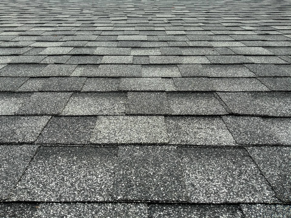 Repairing vs. Replacing Asphalt Shingle Roofing Systems