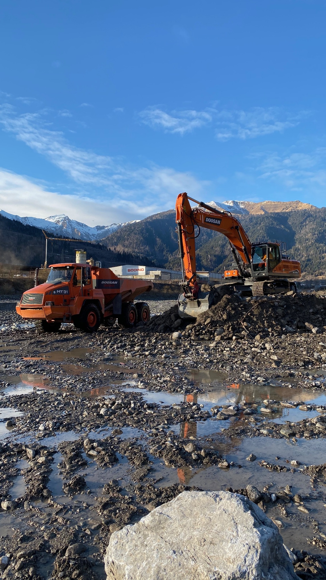 First DX350LC-7 Excavator in Italy Helps Secure Riverbed