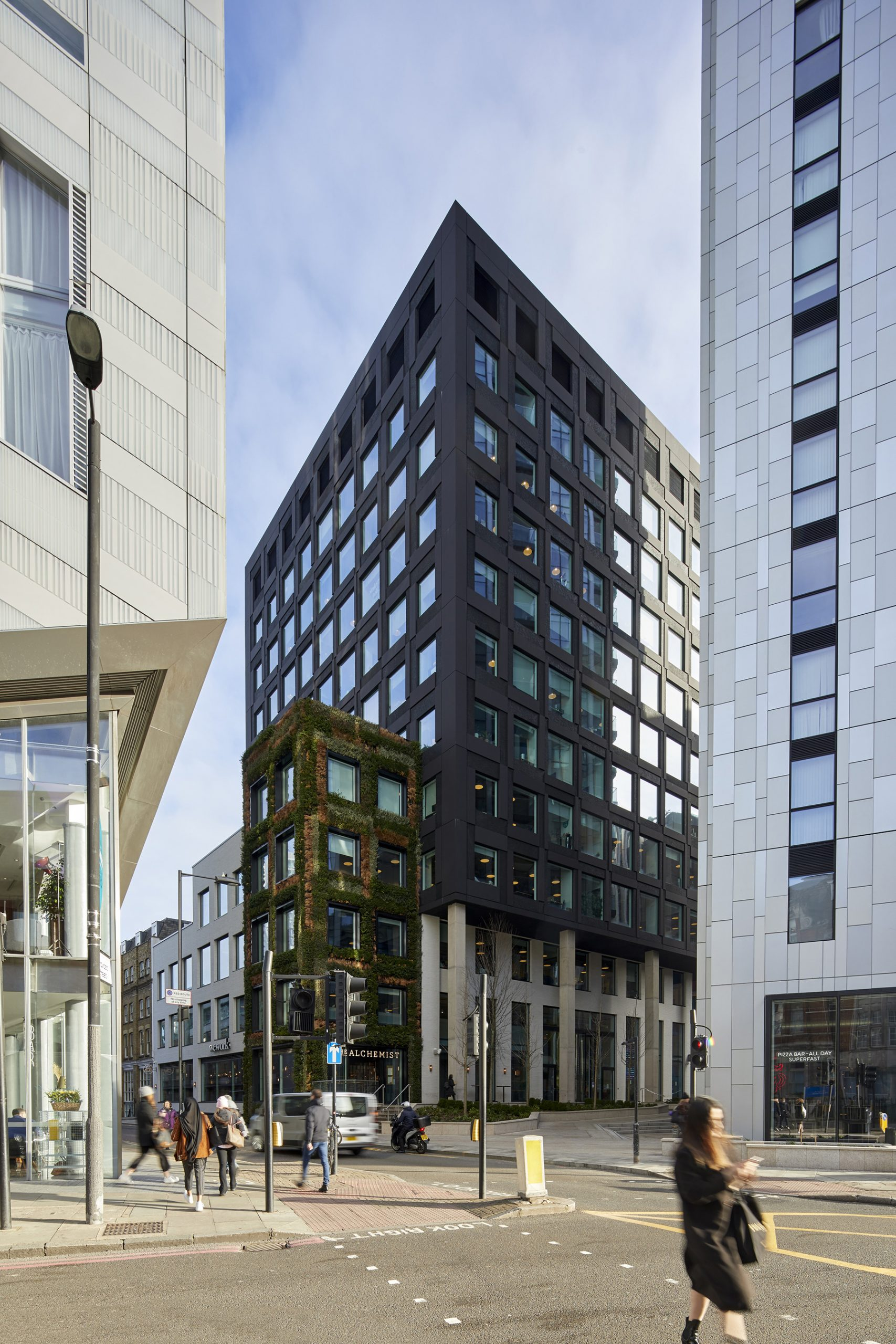 Bespoke curtain walling by Kawneer helps ground a landmark office building